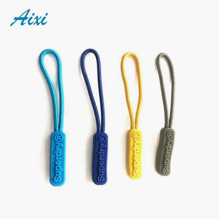 Stylish and durable brand embossed plastic rubber zipper puller